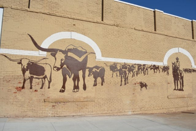 This mural in Enid by artist Paul Stone was created to commemorate the 150th anniversary of the Chisholm Trail. The metal mural depicts life on the Chisholm Trail. [VisitEnid.org]