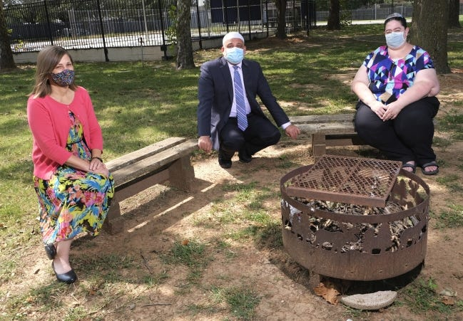 Rabbi Vered Harris, Imad Enchassi, senior imam of the Islamic Society of Greater Oklahoma City, and Abby Jacobson, spiritual leader of Emanuel Synagogue, pose for a photo on the grounds of Temple B'nai Israel in Oklahoma City, where Harris is spiritual leader. [Doug Hoke/The Oklahoman]