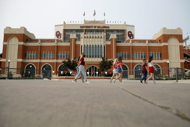 Fans walk past Gaylord Family-Oklahoma Memorial Stadium before a college football game between the University of Oklahoma and Missouri State University in Norman on Sept. 12. [Bryan Terry/The Oklahoman]