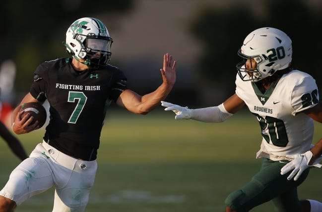 McGuinness's Luke Tarman (7) has gained nearly 1,800 total yards and 21 touchdowns in five games. [Sarah Phipps/The Oklahoman]