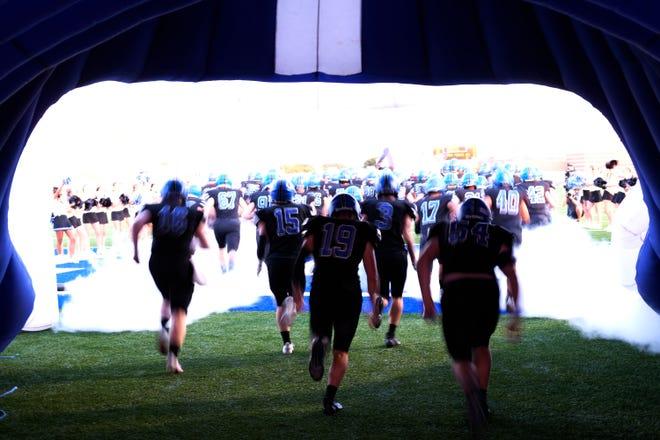 Deer Creek football team runs onto the field during the high school football game between Putnam City North at Deer Creek Monday, October 5, 2020. [Doug Hoke/The Oklahoman]