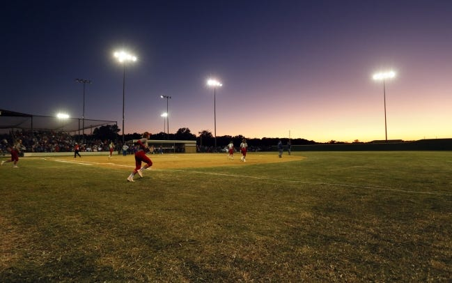 The sun sets during the Class 2A softball championship game last October between Dale and Silo at the Firelake Ball Fields in Shawnee. [Nate Billings/The Oklahoman]