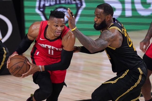 Houston Rockets' Russell Westbrook (0) drives against Los Angeles Lakers' LeBron James (23) during the second half of a conference semifinal playoff game Sunday, Sept. 6, in Lake Buena Vista, Fla. Westbrook left a generous tip for housekeepers inside the bubble. [AP Photo/Mark J. Terrill]