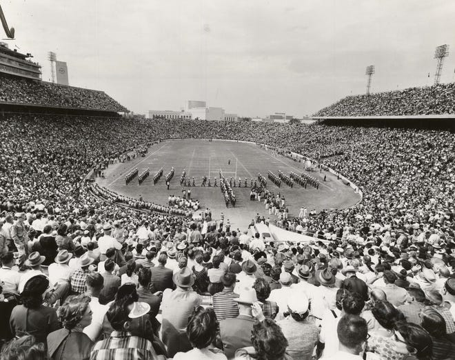 More than 36,000 University of Oklahoma football fans helped fill the Cotton Bowl to its 75,500-seat capacity in October 1956. This photo was published in The Daily Oklahoman the day after the Sooners shut out the University of Texas Longhorns 45-0 in what would be a National Championship season. The Pride of Oklahoma marching band can be seen on the field during halftime. [JOHN GUMM/THE OKLAHOMAN ARCHIVES]