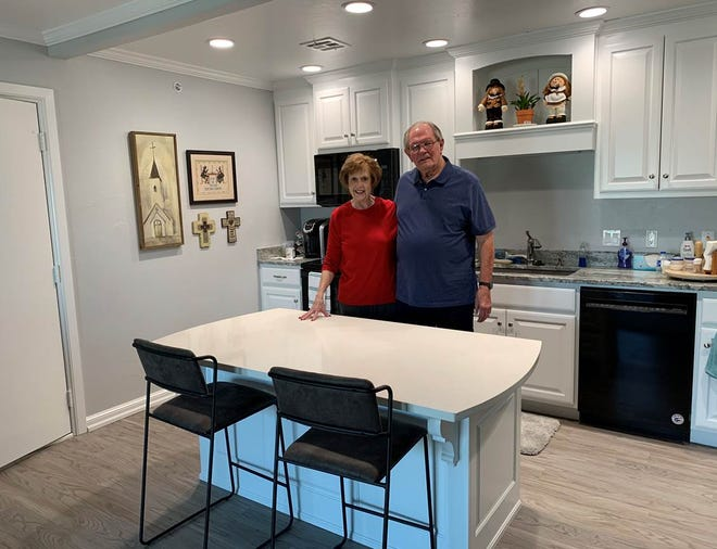 Linda and Mike Bauman enjoy their kitchen in their new apartment at Spanish Cove Retirement Village. [PHOTO PROVIDED]