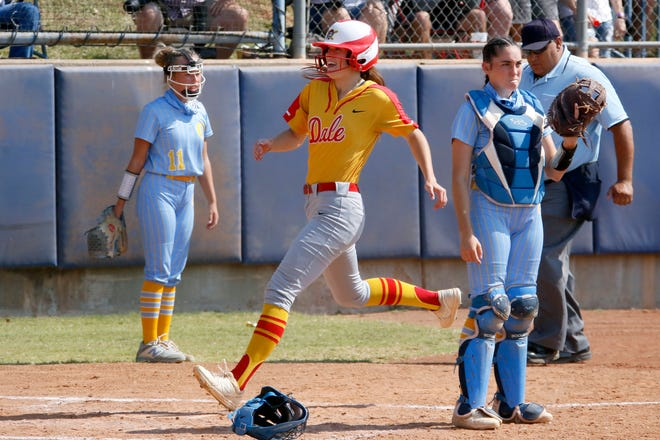 Dale's Anna Hester runs home between Oktaha's Kira Meaders, left, and Brynn Surmont during a Class 2A softball state tournament game at USA Hall Fame Stadium between Dale and Oktaha in Oklahoma City, Thursday, Oct. 8, 2020. [Bryan Terry/The Oklahoman]