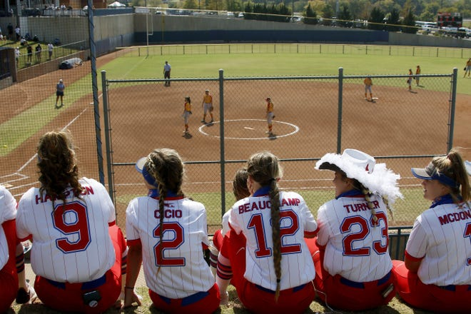 Softball players watch a Class 2A softball state tournament game at USA Hall Fame Stadium between Dale and Oktaha in Oklahoma City, Thursday. [Bryan Terry/The Oklahoman]