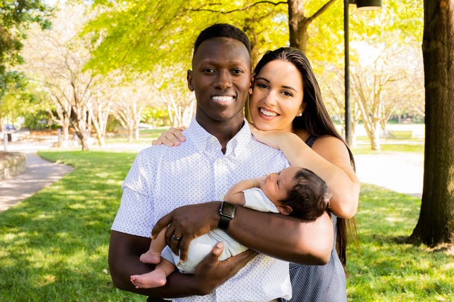 Singer-songwriter Brian Nhira poses for a family photo with his wife, Sonia, and their son, Zayden. [Photo provided]
