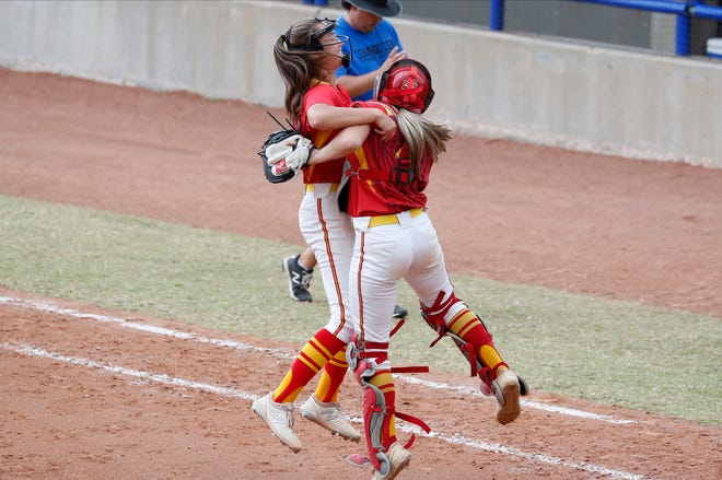 Dale pitcher Addie Bell, left, and catcher, right, celebrate after defeating Stroud during an OSSAA State semifinals high school softball game in Oklahoma City on Friday, Oct. 9, 2020. Photo by Alonzo J. Adams for The Oklahoman.