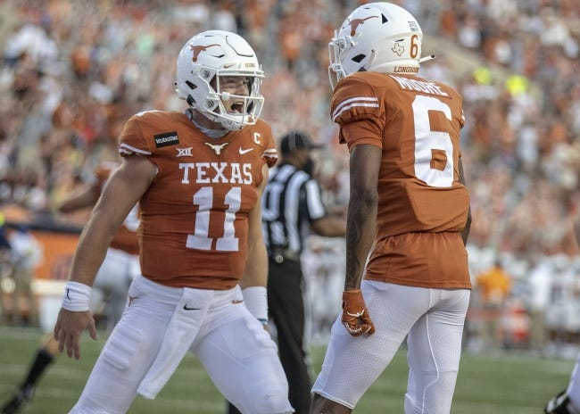Texas quarterback Sam Ehlinger (11) celebrates with Joshua Moore (6) after a touchdown against UTEP on Sept. 12. [Ricardo B. Brazziell/Austin American-Statesman]