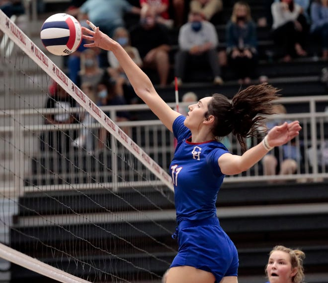 Christian Heritage AcademyÕs Joy Cortesio spikes the ball as Verdigris plays CHA in high school volleyball at Westmoore High School on Oct. 9, 2020 in Moore, Okla. [Steve Sisney/For The Oklahoman]