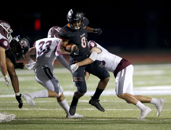 Norman's Jayven Jackson is tackled during Thursday's game between Norman and Jenks in Norman. Jenks won 42-13. [Sarah Phipps/The Oklahoman]