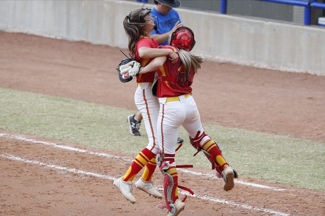 Dale pitcher Addie Bell, left, and catcher, right, celebrate after defeating Stroud during an OSSAA State semifinals high school softball game in Oklahoma City on Friday. [Photos by Alonzo J. Adams/ For The Oklahoman.]