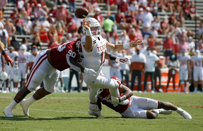 Oklahoma's Josh Ellison (90) and Nik Bonitto (11) put pressure on Texas' Sam Ehlinger (11) during the Red River Showdown college football game between the University of Oklahoma Sooners (OU) and the Texas Longhorns (UT) at Cotton Bowl Stadium in Dallas, Saturday, Oct. 10, 2020. [Bryan Terry/The Oklahoman]