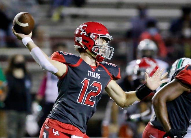Carl Albert's Ben Harris throws the ball during the high school football game between Bishop McGuinness and Carl Albert at Carl Albert High School in Midwest City, Okla., Friday, Oct. 9, 2020. Photo by Sarah Phipps, The Oklahoman