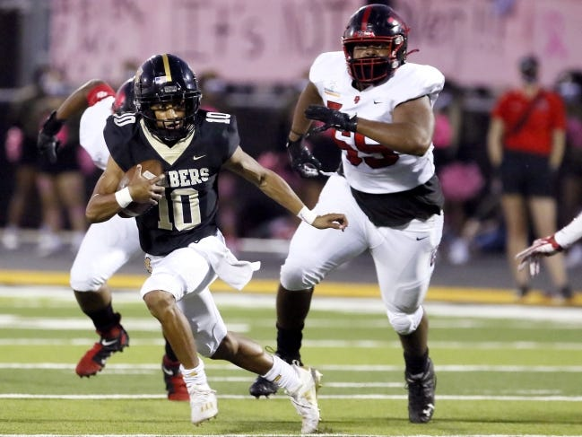 Midwest City's DeAngelo Irvin, Jr. rushes during the high school football game between Midwest City and Del City at Midwest City High School in Midwest City, Okla., Friday, Oct. 9, 2020. Photo by Sarah Phipps, The Oklahoman