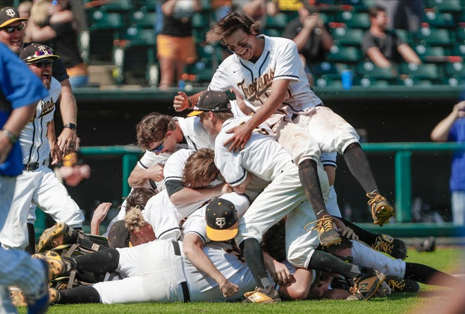 Canute players celebrate after defeating Fort Cobb-Broxton in the Class A fall baseball state title game Saturday at Chickasaw Bricktown Ballpark. [Alonzo J. Adams/For The Oklahoman]