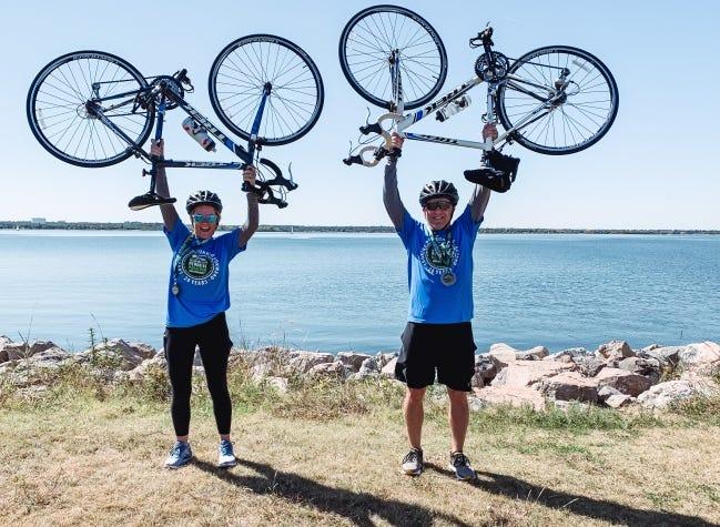 Precia and Greg Barrett celebrate after biking more than 26 miles around Lake Hefner for the Oklahoma City Memorial Marathon last Sunday. [PHOTO PROVIDED]