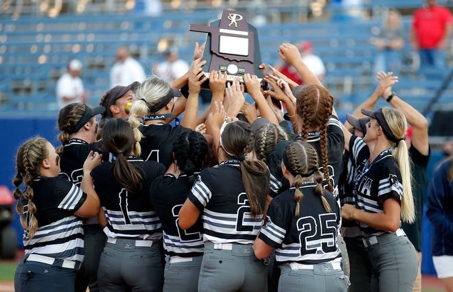 Latta celebrates the Class 2A fast-pitch state softball championship over Dale at the USA Hall Fame Stadium in Oklahoma City, Saturday, Oct. 10, 2020. Photo by Sarah Phipps, The Oklahoman