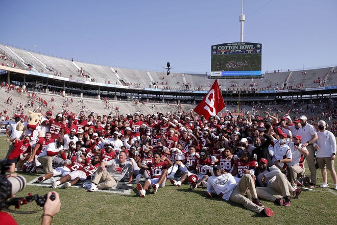 The OU football team poses for a photo after beating Texas 53-45 in four overtimes Saturday at Cotton Bowl Stadium in Dallas. For full coverage, go to Page B1.  [Bryan Terry/The Oklahoman]