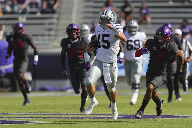 Kansas State quarterback Will Howard (15) carries the ball for an 80-yard run in the first quarter against TCU on Saturday in Arlington, Texas. [AP Photo/Richard W. Rodriguez]