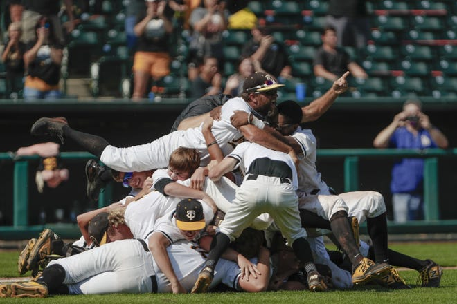 Canute celebrates after defeating Fort Cobb-Broxton during the OSSAA Class A fall baseball championship at the Chickasaw Bricktown Ballpark in Oklahoma City on Saturday. [Alonzo J. Adams/For The Oklahoman]