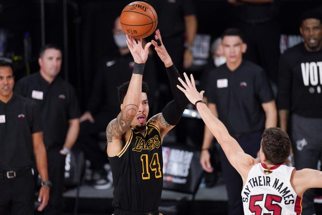Los Angeles Lakers guard Danny Green (left) shoots over Miami Heat guard Duncan Robinson during the second half in Game 5 of the NBA Finals on Friday in Lake Buena Vista, Fla. [AP Photo/Mark J. Terrill]