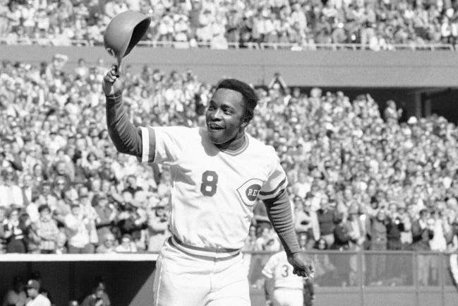 Hall of Fame second baseman Joe Morgan, pictured in 1976 tipping his hat to Cincinnati Reds fans during a World Series sweep of the New York Yankees, died Sunday at his home in Danville, Calif. [AP Photo/File]