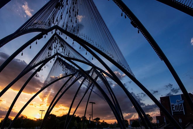 """Enid artist Romy Owens' large-scale public artwork """"Under Her Wing Was the Universe"""" is seen at sunset. [Tanya Mattek photo]"""