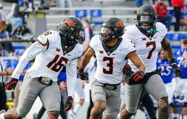 Oklahoma State linebacker Devin Harper (16), safety Tre Sterling (3) and linebacker Amen Ogbongbemiga (7) are part of the core of veterans on the Cowboy defense. [JAY BIGGERSTAFF/USA TODAY SPORTS]