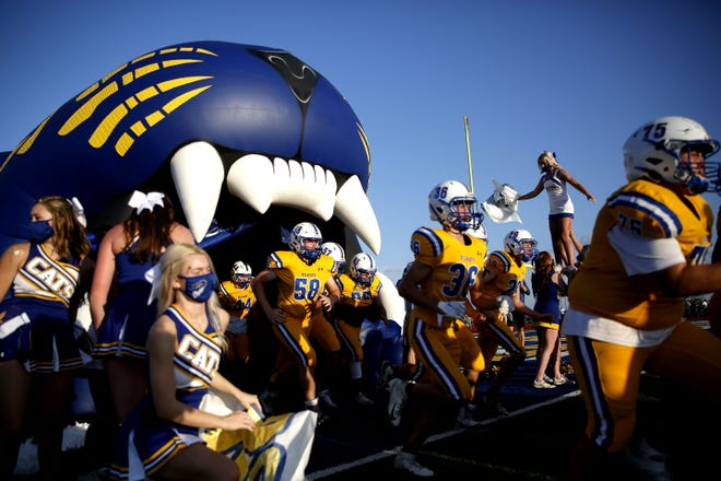 Piedmont runs onto the field before its game against El Reno on Sept. 4. [Sarah Phipps/The Oklahoman]