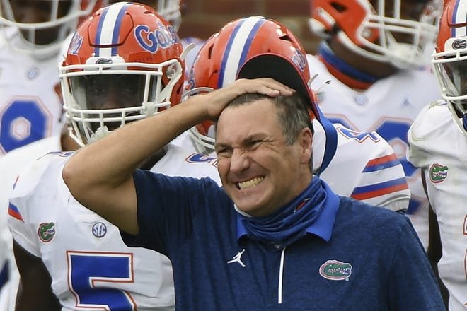 Florida head coach Dan Mullen reacts during the second half of an NCAA college football game against Mississippi in Oxford, Miss., Sept. 26. Mullen was given several more chances Monday to walk back bizarre comments about wanting to pack 90,000 screaming fans inside Florida Field during the coronavirus pandemic. He declined each of them, brushing aside criticism and insisting he's focused on defending national champion LSU. [AP Photo/Thomas Graning]