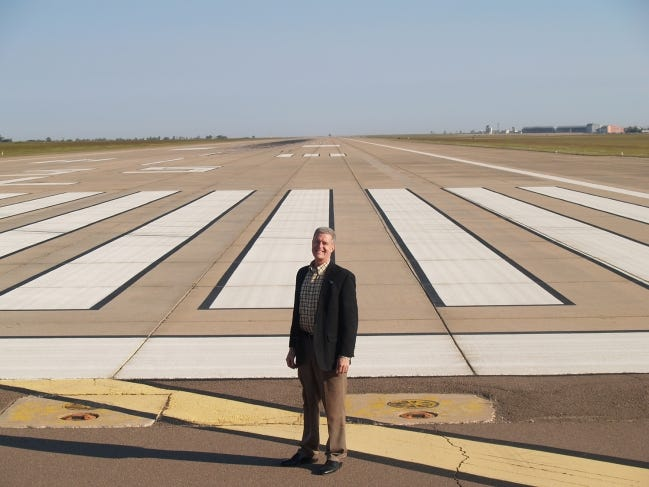 Craig Smith, executive director of the Oklahoma Space Industry Development Authority, stands at the approach of one of OSIDA's key assets, a 2.5 mile-long runway in Burns Flat that makes up part of the Oklahoma Spaceport. Smith, who was hired this year, wants to focus the authority on the core business of developing Oklahoma's space industry. [ROD SERFOSS/CLINTON DAILY NEWS]