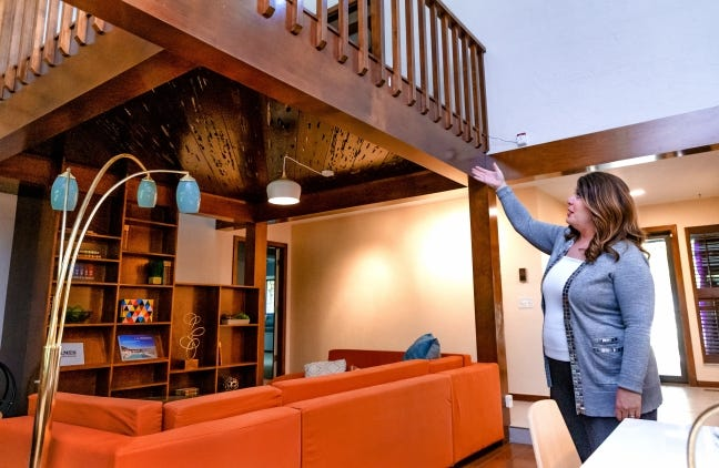 Kirsten McIntyre, an agent with Keller Williams Realty Central Oklahoma, points out features in the living room of a home she has listed for sale at 11407 Red Rock Road in the Quail Creek area of northwest Oklahoma City. [CHRIS LANDSBERGER/THE OKLAHOMAN]
