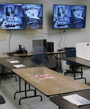 The public viewing area of the Oklahoma County Election Board is pictured on Wednesday. The election board had to change up its procedures this year to count mail-in ballots. Taking all COVID precautions, ballot counters can only be monitored from video monitors mounted on the wall. [Doug Hoke/The Oklahoman]