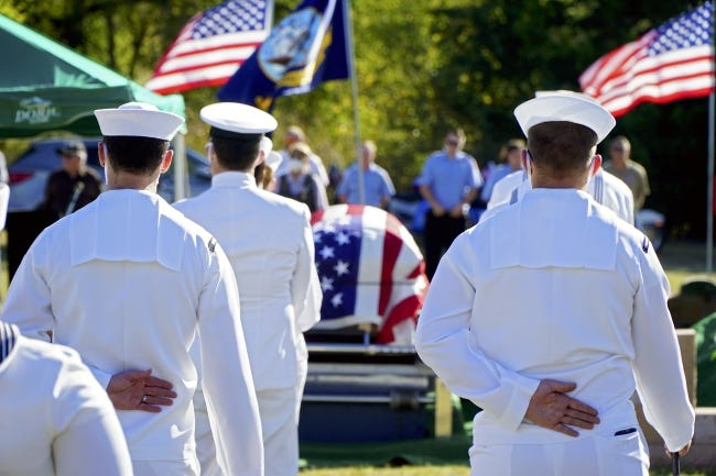 Facing the casket, sailors from the Wichita Navy Reserve stand at attention Wednesday during the funeral for Rex E. Wise, an Oklahoma native killed at Pearl Harbor. [Jordan Green/The Blackwell Journal-Tribune]