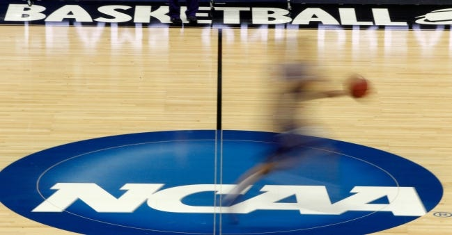 College football's power brokers want full autonomy but want to stay a part of March Madness. [AP Photo/Keith Srakocic, File]
