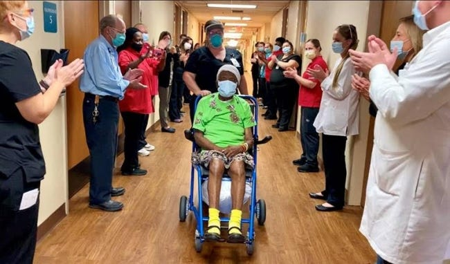 Staff at Mercy Hospital Logan County clap as Della Hathorne, a 102-year-old COVID-19 survivor, is released from the hospital on Wednesday in Guthrie. [Mercy Hospital]