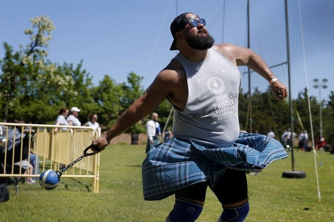 Ryan Huddleston, of Yukon, throws in the lightweight for distance competition April 27, 2019, during the Iron Thistle Scottish Festival. [Bryan Terry/The Oklahoman Archives]