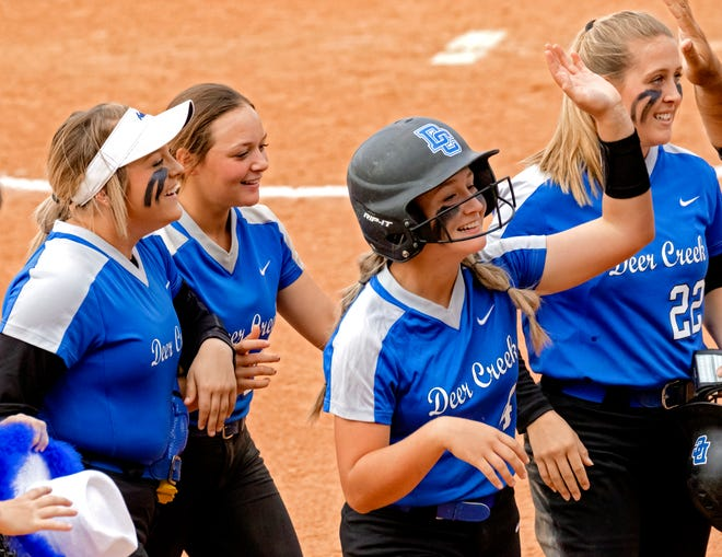 Deer Creek's Ashlee Hogg (4) celebrates with teammates after Hogg hit in the game winning run against Mustang during the high school state championship fast pitch softball quarterfinals at ASA Hall of Fame Stadium in Oklahoma City, Okla. on Thursday, Oct. 15, 2020. [Chris Landsberger/The Oklahoman]