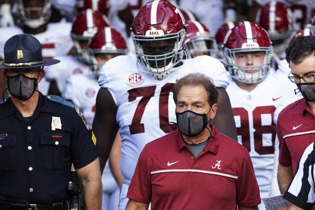 Second-ranked Alabama is set to face No. 3 Georgia on Saturday, and will likely be without coach Nick Saban, who tested positive for COVID-19. [AP Photo/L.G. Patterson, File]