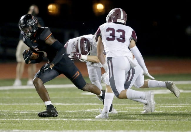 Norman receiver Jaden Bray, who has committed to play at Oklahoma State, run after a catch against Jenks last Thursday. Bray joined the football team his junior season after devoting much of his time to basketball. [Sarah Phipps/The Oklahoman]