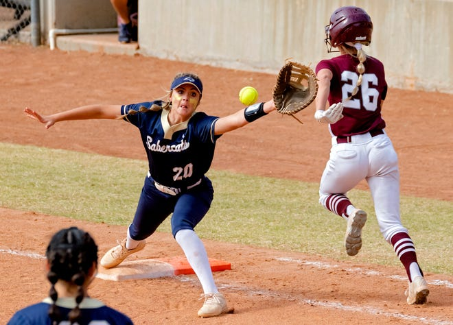 Southmoore's Kaylee Carter (20) gets the out on Jenks' Dacia Sexton (26) during the high school state championship fast pitch softball quarterfinals at ASA Hall of Fame Stadium in Oklahoma City, Okla. on Thursday, Oct. 15, 2020. [Chris Landsberger/The Oklahoman]