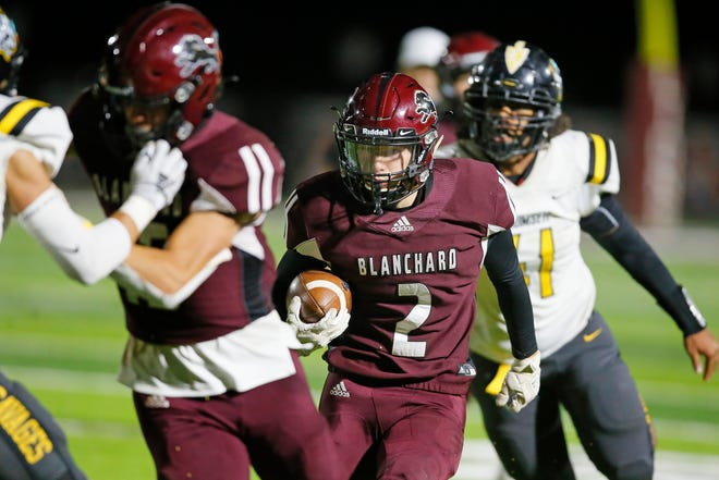 Blanchard's Whit Carpenter carries the ball during Thursday's game against Tecumseh in Blanchard. [Bryan Terry/The Oklahoman]