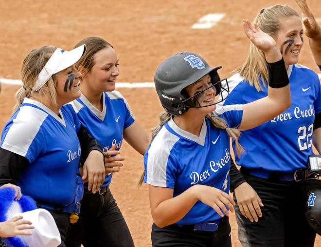 Deer Creek's Ashlee Hogg (4) celebrates with teammates after hitting in the game-winning run against Mustang during the state softball quarterfinals Thursday at the USA Softball Hall of Fame Complex. [Chris Landsberger/The Oklahoman]