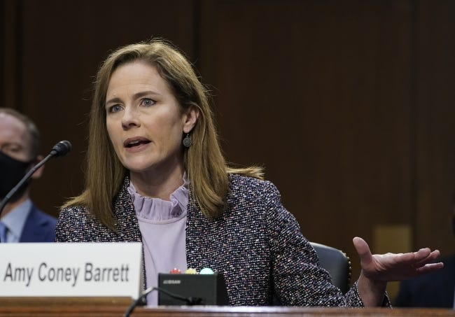 Supreme Court nominee Amy Coney Barrett testifies before the Senate Judiciary Committee during the third day of her confirmation hearings. (Drew Angerer/Pool via AP)