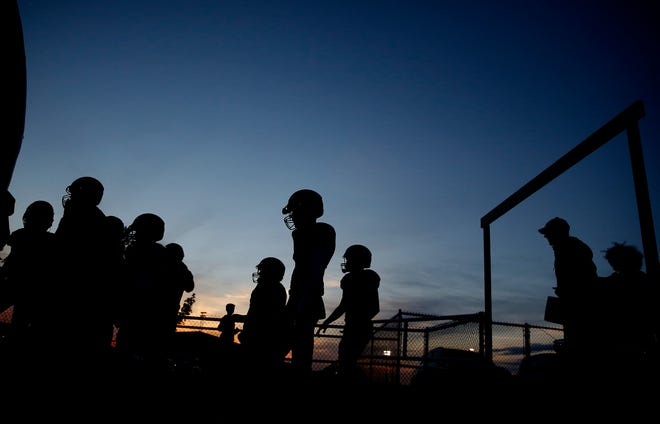Kingfisher walks on to the field during the high school football game between Kingfisher and Perkins-Tryon at Kingfisher High School in Kingfisher, Okla. Thursday, Oct. 15, 2020. Photo by Sarah Phipps, The Oklahoman
