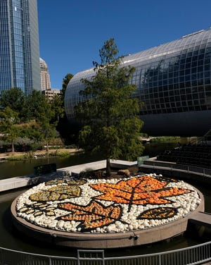Local artist Nick Bayer's giant pumpkin mosaic on the Myriad Gardens Water Stage for the Myriad Gardens Great Pumpkin Patch is seen on Monday, October 12, 2020. [Doug Hoke/The Oklahoman]