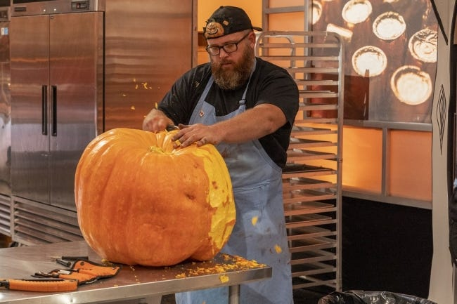 """Team Mummies Rejects pumpkin carver Daniel Miller, who hails from Wilson, Oklahoma, works during Episode 2 of """"Halloween Wars"""" Season 10. [Food Network photo]"""