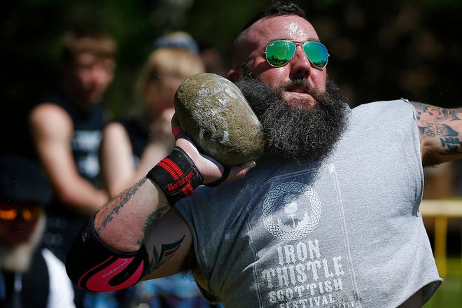 Ryan Fontenot of Yukon, Okla., competes in the stone throw competition during the Iron Thistle Scottish Festival in Yukon, Saturday, April 27, 2019. [Bryan Terry/The Oklahoman Archives]